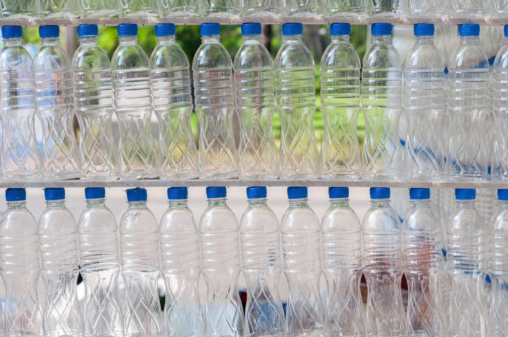 A wall of empty plastic bottles
